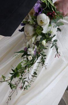 White and purple cascade bridal bouquet.