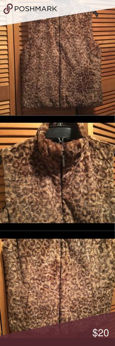 """Reversible Animal Print Faux Fur and Brown Vest Reversible vest with faux fur animal print on one side and brown on the other side with a platinum color zipper. Size Small/medium. Measures 29"""" from arm pit to arm pit and 25"""" long. NWOT Jackets & Coats Vests"""