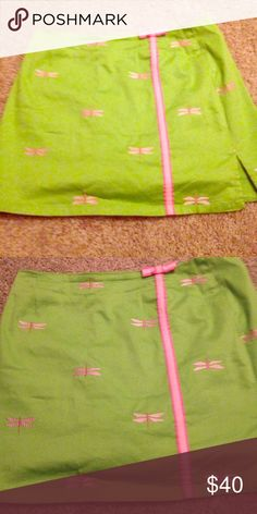 Lilly Pulitzer green and pink dragon fly shirt This is a skirt With shorts under it. Super cute! No flaws. Size 6 Lilly Pulitzer Skirts Mini