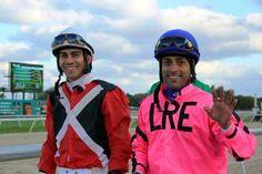 Antonio Gallardo (white helmet-red/black silks) and Daniel Coa (blue helmet-pink silks) return to the Jockey Room @Tampa Bay Downs