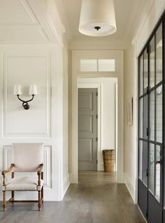 Timeless Style in Kiawah by Beth Webb Interiors | InCollect - lovely classic entry with Black French Doors and white walls