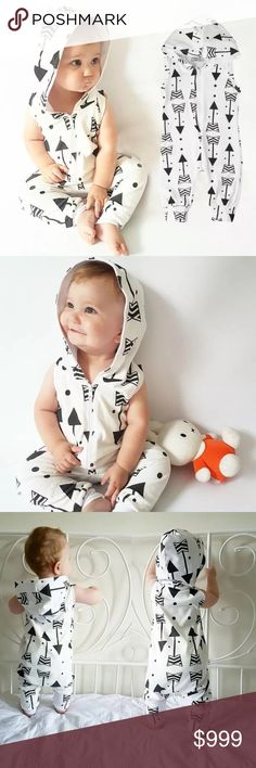 Just In Adorable lightweight hooded Romper that zips in the front, with black arrow pattern. Available in Sizes 3-6m, 9-12m One Pieces Bodysuits