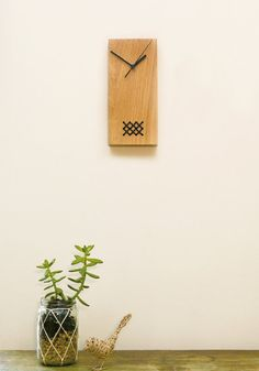 A unique embroidered clock. A beautiful piece for your home or office wall.