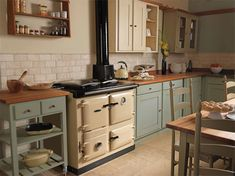 Rayburn image gallery solid fuel cookers, boilers & stoves k Cosy Kitchen, Kitchen Stove, Kitchen Cabinets, Kitchen Layout, Rustic Country Kitchens, Cottage Kitchens, Classic Home Decor, Classic House, Rayburn Cookers