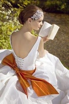 love the orange bow and the reading bride