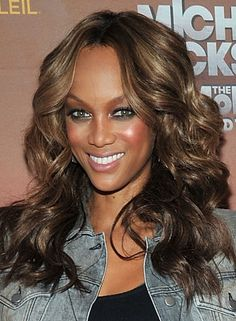 Tyra Banks    Where: Michael Jackson: THE IMMORTAL World Tour show by Cirque du Soleil at Madison Square Garden in New York City.    Why: Banks went for a long, lush look complete with chunky ringlets and ash blonde highlights.
