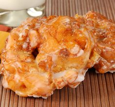 Simple Apple Fritters Recipe -- Instead of dusting with sugar, mix confectioner's sugar. a tsp. of milk, and a 2-3 drops of vanilla or almond extract, and drizzle over pastries.