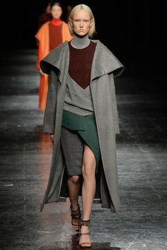 Prabal Gurung | Fall 2014 - Long big collar coat. Theatrical. Forest green with grey and burgundy. Seasonally confused shoes.