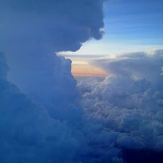 Picture of the clouds from the window seat on an AA jet.