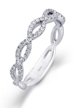 Win this 18K white gold pave criss-cross Simon G. wedding band along with an ENTIRE luxury wedding, a gown by David's Bridal, a honeymoon in the Cayman Islands and so much more. To enter: facebook.com/brideslivewedding