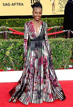 Lupita Nyong'o SAG Awards 2015 Proving that she can do no wrong on the red carpet, the Non-Stop actress turned heads in a long-sleeved Elie Saab gown paired with Sophia Webster heels.  Read more: http://www.usmagazine.com/celebrity-style/pictures/sag-2015-red-carpet-fashion-best-dressed-2015251/43681#ixzz3PvlzJnuf  Follow us: @usweekly on Twitter | usweekly on Facebook
