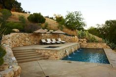future backyard pool on terraced hillside