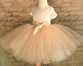Flower Girl long sewn tutu in champagne tulle sashed with gold satin.. $90.00, via Etsy.
