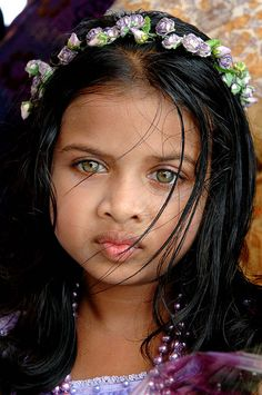 girl, Maldives Wow, you don't usually see such dark hair with those color of eyes