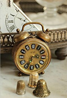 vintage clock and thimbles