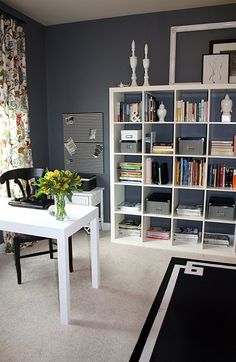 Nicely organized home office with style. Cube shelves hold supplies in pretty black and white bins, and some books. French boards are in matching black and white pattern.