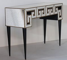 """Greek key design modern console table with antiqued mirror finish. Dimensions: W 49 1/2"""" x D 17.75"""" x H 36"""" (Some assembly required) Item No: PE023"""