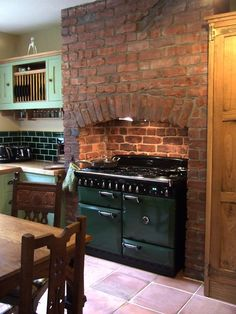 Kitchen with wonderfully wonky original brick chimney breast uncovered during the renovation Kitchen Cooker, Kitchen Stove, Victorian Kitchen, Vintage Kitchen, Interior Exterior, Kitchen Interior, Brick Chimney Breast, Cooker In Chimney Breast, Kitchen Chimney