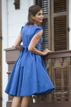 In a Cinch Dress blue from the Spring Collection by Shabby Apple