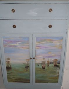 Blue cupboard & drawers with hand-painted ships by Furniturefruit