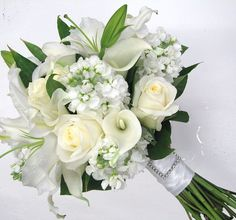 classic white bridal bouquet with oriental lilies, calla lilies, roses, & stock by Studio Bloom