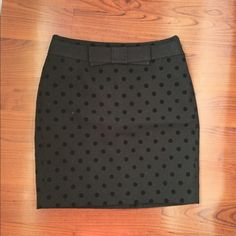 LOFT black polka dot skirt Adorable black polka dot skirt with front bow detail. Zips on the side. Velour dots on a wool blend skirt with inner lining. Size 0P. Fits 00 or 0. LOFT Skirts