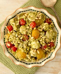 For this recipe, combine Israeli couscous with prepared pesto sauce, red and yellow tomatoes, fresh mozzarella balls and toasted pine nuts.