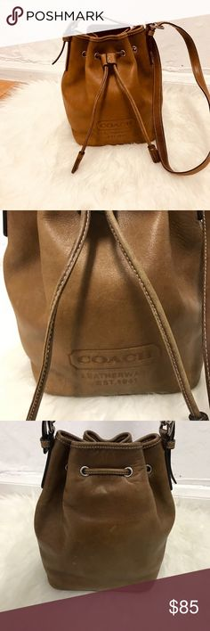 Vintage Coach leather bucket bag Beautiful. I rage Coach leather bucket bag, perfect for everyday use. Adjustable shoulder strap, small but very roomy. String closure with zipper pocket inside. Clean inside with a few pen marks as shown in pictures. Outside good condition overall, true leather shoes character with age and this beauty shows it. BUNDLE & SAVE 15% ❌TRADES❌🎉171317🎉 Coach Bags