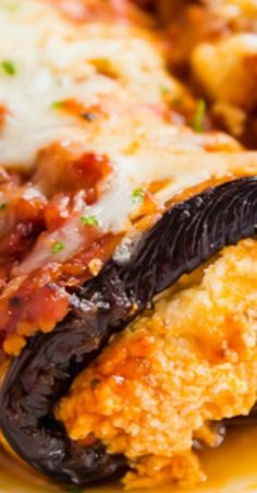 Eggplant Rollatini is an extra special meal that is surprisingly easy to prepare! It's stuffed with cheese and topped with a ground veal tomato sauce. Italian Dishes, Italian Recipes, Rollatini, Amish, Tomato Sauce, Eggplant, Meals, Food, World