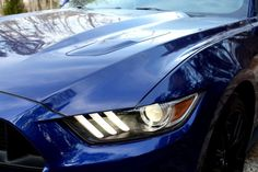 Smoky burnouts come standard on Ford's refined but still untamed 2015 Mustang 2015 Ford Mustang GT headlight