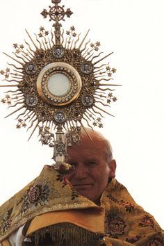 Pope John Paul II with Monstrance, also known as an ostensorium or an ostensory.