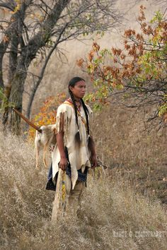 A serious male portrait of a young Native American Sioux Indian boy standing on a hill in South Dakota during the fall season - Nancy G Photography © Nancy Greifenhagen Native American Pictures, Native American Beauty, Indian Pictures, American Indian Art, Native American Tribes, Native American History, American Indians, Indiana, Saloon