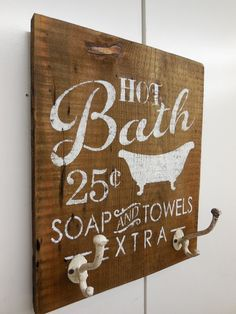 Vintage bath sign turned towel hanger.