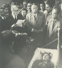 Shortly after turning 47, Frida Kahlo tragically died from a pulmonary embolism, however some suspected she died from an overdose that may or may not have been accidental. Here, Frida can be seen in her coffin, as her husband (pictured center) solemnly looks on. Diego wrote that the day that Kahlo died was the most tragic day of his life.