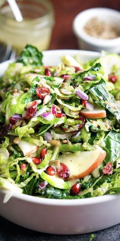Festive AND healthy! Brussels sprout salad is superfood LOADED, sweet and savory, and has tons of texture in every bite! Healthy Recipes On A Budget, Vegetarian Recipes Dinner, Healthy Salad Recipes, Vegan Dinners, Healthy Dinner Recipes, Appetizer Recipes, Nutrition, Festive, Winter Recipes