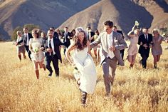 Love this photo of the Bride and Groom with the wedding party...Run for it!