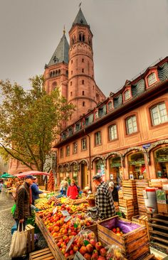 https://flic.kr/p/5Q4UhW | Saturday Market in Mainz | Saturday market in downtown Mainz, around the corner from the beautiful cathedral. Mainz is a very nice old town, forming part of the roman empire. It is also the birth place of Gutenberg, and there is a nice Gutenberg museum with many old books and history of the printing press. Pretty cool. Germany.