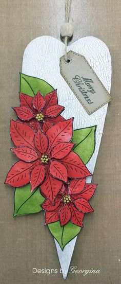 Wooden Christmas heart. Using Poinsettia Tag stamps set. DecoArt white Crackle paint for the background.