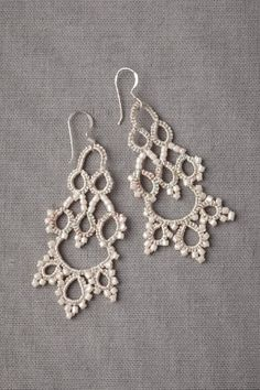 "Muted tones quietly curl into crocheted loops that hang in between beaded scallops and chevrons. From L'Orina. 2.5""L, 1""W. Glass pearls, cotton and polyester thread, silver. Handmade in France. bhdl"