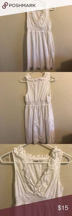 Spring Old Navy Dress White dress that's perfect for spring and summer. It's got a deep cut on the chest but still modest. Elastic waistband and a cute flower design traced in the fabric. Lining underneath the dress. Worn a few times, but the main use was for my graduation. Old Navy Dresses