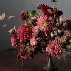 We're knee deep in dahlia season and we LOVE this berry toned bouquet by