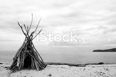 A Driftwood Cairn and beach background on a grey cloudy day in the. Abel Tasman National Park, Beach Background, Cloudy Day, Image Now, Driftwood, Monochrome, National Parks, Royalty Free Stock Photos, Black And White