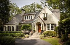 Soft white brick, white trim, smokey grey shutters, and an antiqued roof make for the perfect brick home!