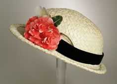 Woman's Bowler  Sally Victor (United States, 1905-1977)  United States, circa 1948  Costumes; Accessories  Lacquered straw, silk velvet ribbon, silk flower  Diameter: 10 in. (25.4 cm); Height: 4 in.