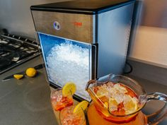 Give your drinks the perfect blend of taste, texture, and temperature with help from the counter top nugget ice machine. Simply fill it up with clean water and you'll be able to whip up to one pound of easily chewed flavor absorbing nugget ice per hour. Cooking For A Crowd, Cooking On The Grill, Autocad, L Shaped Island, Nugget Ice Maker, Patio Store, Basic Kitchen, Kitchen Bars, Smart Kitchen