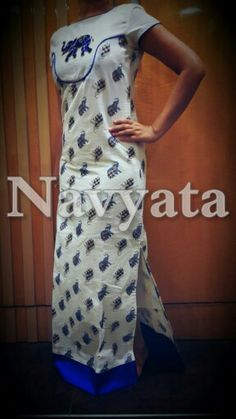 Long cotton dress with an Elephant cutdaana motif on yoke. For further details contact us on + 919892398900, + 919930413660