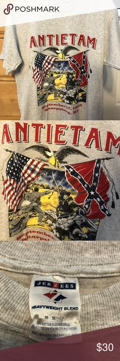 Vintage Civil War Antietam Graphic T-Shirt Vintage 90's Civil War Antietam Graphic T-Shirt  -Size Medium  -Jerzees print  -NWOT, never has been worn  -Antietam battle print on the front  -Heather gray  -Great for any Civil War buff or connoisseur of vintage items  -Tap in Jerzees Shirts Tees - Short Sleeve