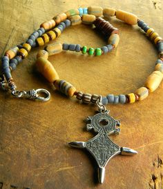 Old African Sandcast Beaded Necklace with Taureg Cross by Gloria Ewing.