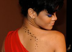 Google Image Result for http://www.celebritynewsclub.com/wp-content/uploads/2012/02/Rihanna-A-Trail-of-Stars-Going-Down-Her-Back-Tattoo.jpg