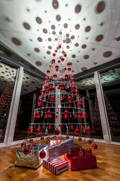 Crystal Clear Modern Christmas Tree with Red Glass Bulbs.
